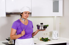 Female cook in her kitchen Stock Photo