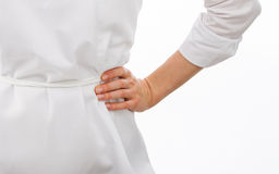 Female cook holding hand on waist Stock Photo