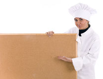 Female cook keeping cork board Royalty Free Stock Image