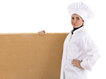 Female cook keeping cork board Stock Image