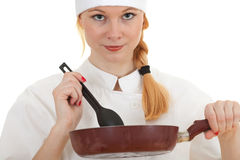 Female cook keeping frying pan Royalty Free Stock Image