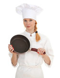 Female cook keeping frying pan Royalty Free Stock Photography