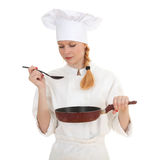 Female cook keeping frying pan Royalty Free Stock Images