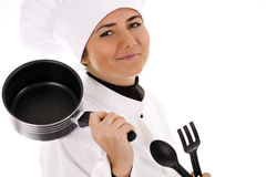 Female cook keeping kitchen utensil Stock Photo