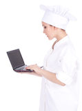 Female cook with laptop Stock Photos