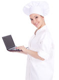 Female cook with laptop Royalty Free Stock Photos