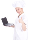Female cook with laptop, thumb up Royalty Free Stock Photo