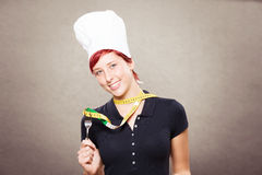 Female cook with a measuring tape Stock Photos