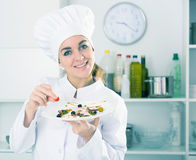 Female cook preparing food Stock Image