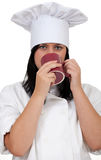 Female cook with red cup Stock Image