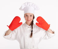 Female cook in red kitchen gloves Stock Images