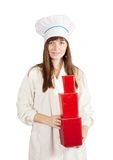 Female cook with   red  packages Stock Photos