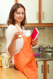 Female cook relaxing in kitchen. Stock Image