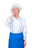 Female cook showing appetizing sign Royalty Free Stock Photos