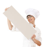 Female cook showing blank paper Stock Photo