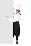 Female Cook Standing Behind The Placard Stock Photography