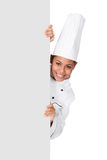 Female Cook Standing Behind The Placard Stock Image