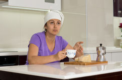 Female cook taking a break from cooking Royalty Free Stock Photos