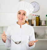 Female cook tasting food Royalty Free Stock Image