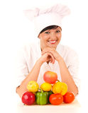 Female cook in uniform with fruit and vegetables Royalty Free Stock Photo