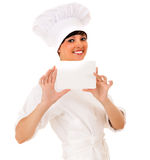 Female cook in uniform keeping card Royalty Free Stock Image