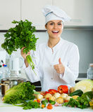 Female cook vegetarian meal Royalty Free Stock Images