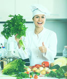 Female cook vegetarian meal Stock Photos