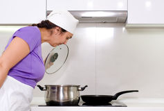 Female cook watching a pot boil Stock Photos