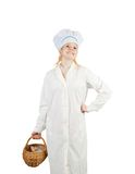Female cook with  wicker basket Stock Photo