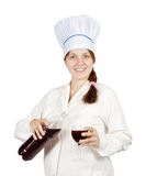 Female cook with wine Royalty Free Stock Image
