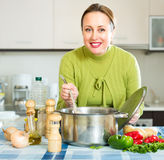 Female cooking healthy soup Royalty Free Stock Photos