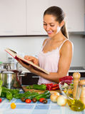 Female cooking with veggies at home Stock Photos