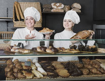 Female cooks demonstrating and selling pastry in the cafe Stock Photography