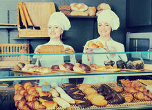Female cooks demonstrating and selling pastry in the cafe Stock Image