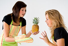 Female cooks and pineapple Royalty Free Stock Photos