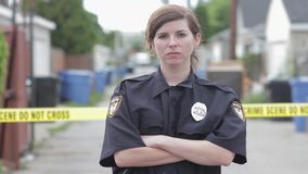 Female cop with arms crossed hd. Female cop with arms crossed 1080p stock video footage