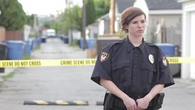 Female cop at a crime scene hd stock footage