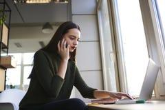Female copywriter searching new ideas on internet websites stock photography