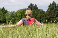 Female in a corn field Stock Images