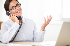 Female corporate executive talking on the phone Royalty Free Stock Images
