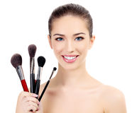 Female with cosmetic brushes Royalty Free Stock Photos