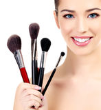 Female with cosmetic brushes Royalty Free Stock Photography
