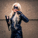 Female cosplayer dressed as 'Black Canary' from DC Comics Stock Photo