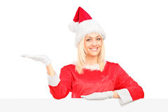 Female in costume standing behind a billboard Stock Images