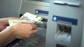 Female counting Russian rubles withdrawn from ATM, 24h service, easy banking. Stock photo royalty free stock photography