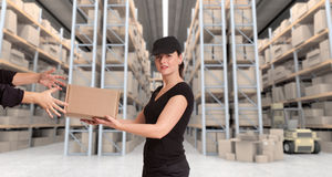 Female courier at distribution warehouse a Stock Images