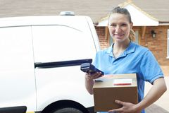 Portrait Of Female Courier With Van Delivering Package To House. Female Courier With Van Delivering Package To House stock photos