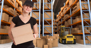 Female courier at warehouse a Stock Photos
