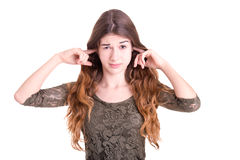 Female Covering Her Ears Royalty Free Stock Images