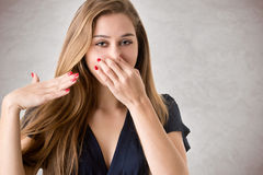 Female Covering Her nose Royalty Free Stock Image